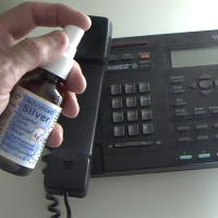 Spray Colloidal Silver on Office Telephone